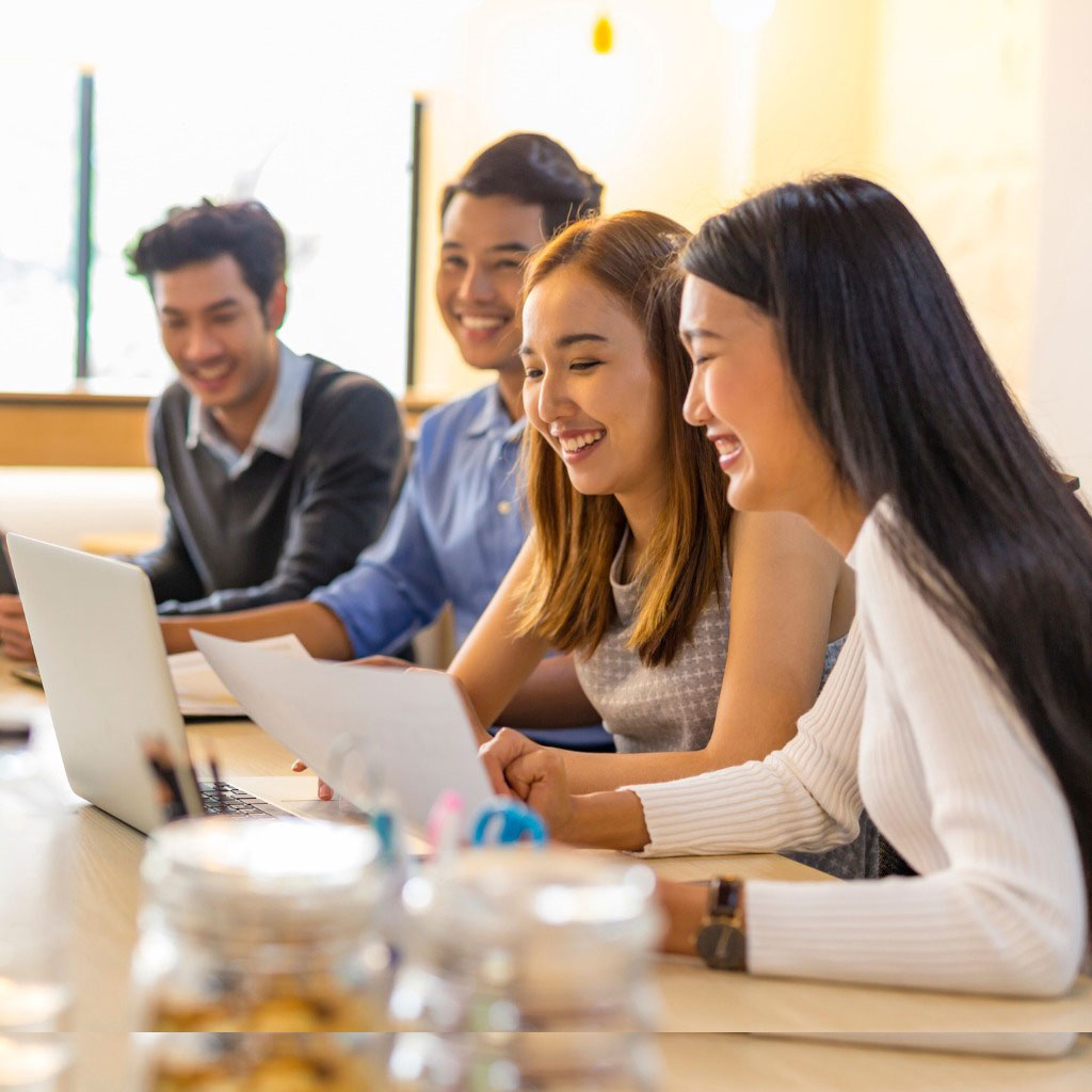 business-meeting-of-young-asian-start-up-entrepreneurs-picture-id694028804
